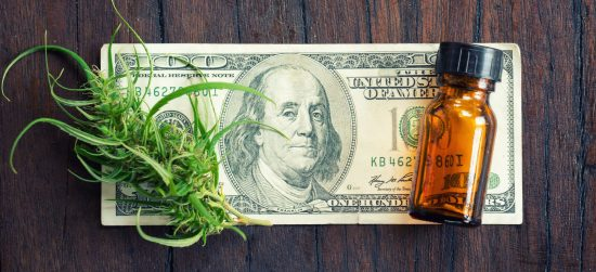 cannabis with cannabidiol (cbd) extract on hundred dollar banknote
