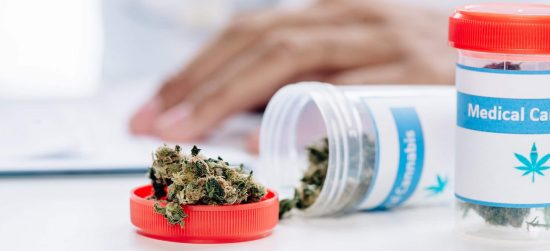 selective focus of bottle with medical cannabis on white table